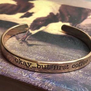 Gold tone inscribed open back bracelet